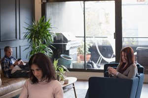 Businesswoman by colleague using tablet at table