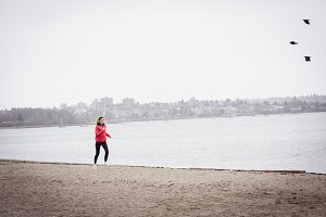 Woman jogging in the beach