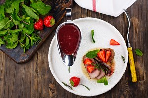 Grilled veal steak with couscous and strawberry sauce