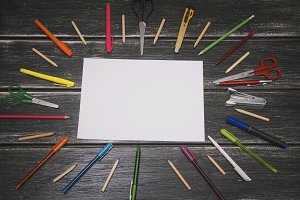 Stationery and white blank - colorful pencils and stuff equipment on wooden background