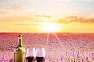 Wine against lavender landscape.