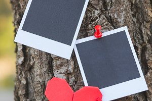 Instant photos with origami heart