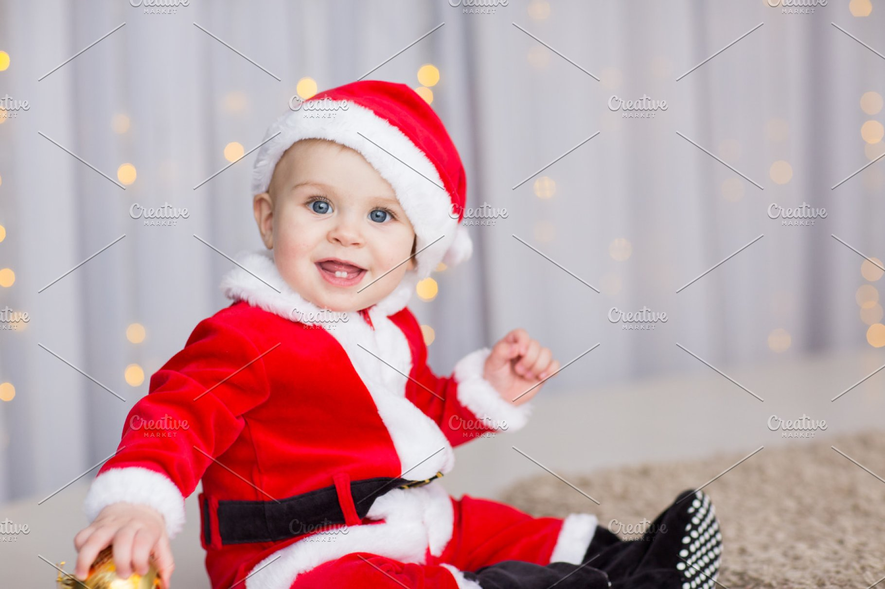 2ddff50198ccd funny baby boy weared in Santa hat with golden Christmas ball ...