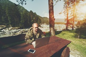 Mature forester man with laptop