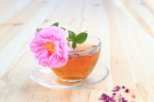 Cup of tea and tea rose.