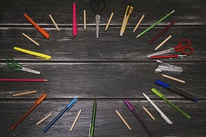 Stationery - colorful pencils and stuff equipment on wooden background