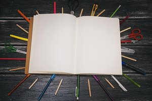 Stationery and notebook - colorful pencils and stuff equipment on wooden background