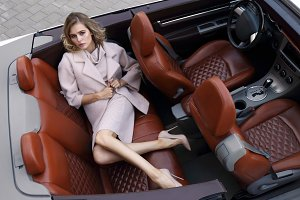 Fashion young woman in cabriolet car