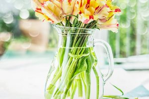 Lovely tulips bunch in glass vase