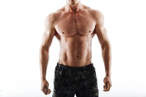 Cropped image of strong handsome young sportsman