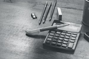 calculator and pencil on a table