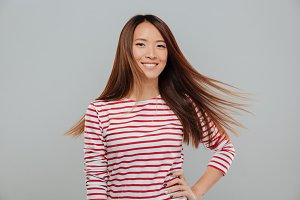 Portrait of a happy pretty asian girl with long hair