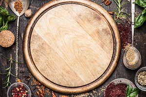 Food spices around cutting board