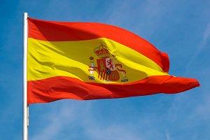 Spanish Flag of Spain over blue sky