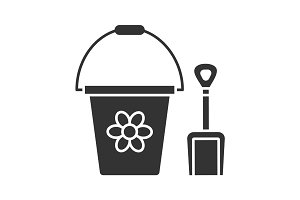 Children's bucket and shovel glyph icon