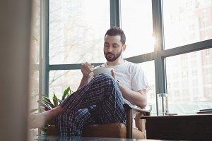 Man having breakfast in the living room