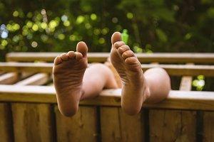 Boy relaxing in log cabin