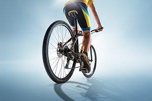 The bicyclist on gray, studio shot.