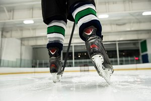 Low section of player playing ice hockey