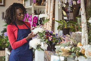 Female florist touching flowers