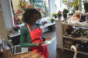Female florist using digital tablet