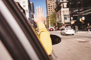 Woman gesturing while driving car