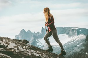 Woman adventurer hiking in Norway