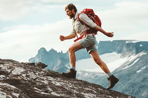Man skyrunning in mountains