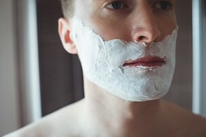 Handsome man with shaving foam