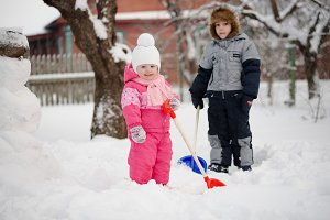 children clear the way from snow