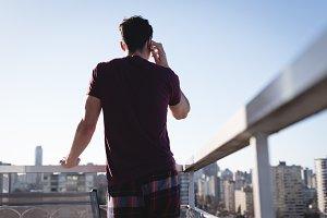 Man talking on mobile phone in terrace