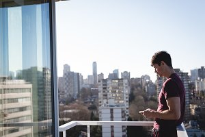 Man using mobile phone on terrace