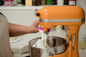 Woman preparing cake batter in the kitchen