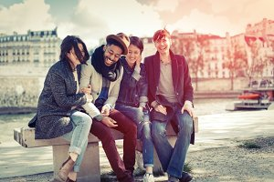 Multi-ethnic Group Of Friends Having Fun In Paris Along Seine