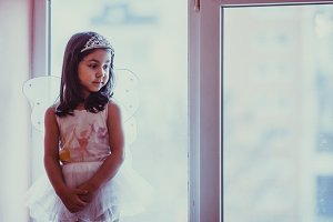 Girl playing on the windowsill