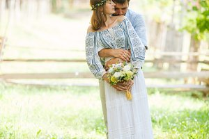 Eclectic rustic wedding couple