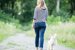 Woman walking with a pet