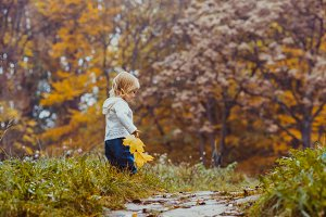 Baby in the autumn park