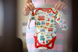 A mother keeps baby clothes