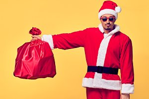 Santa Claus. Young Happy Santa. Sack bag Presents