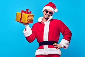 Santa Claus.Young Happy Santa Man, Christmas Gifts