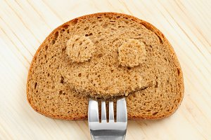 Bread slice as smiling face
