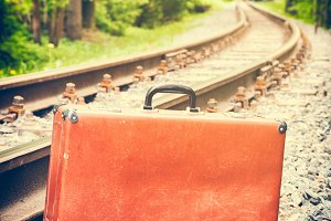Retro suitcase on railway