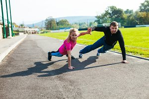Man and woman doing push-up