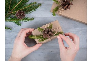 hands give wrapped christmas holiday present