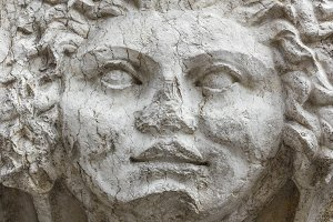 Mask of medusa in stone