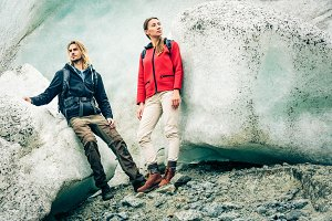 Young Couple Hiking On Glacier