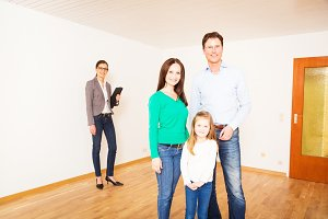 Family Of Three With Their Real Estate Agent