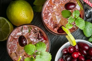 Cranberry mojito on rustic wood background