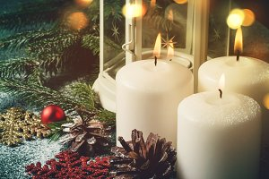Christmas composition with burning candles and decorations